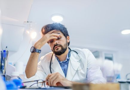 Stressed Doctor Experiencing Physician Burnout